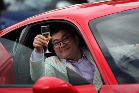 man-smiling-car-champagne-wealthy